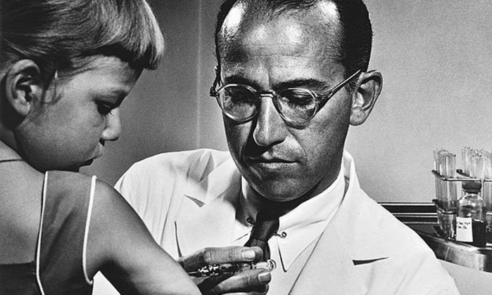 a biography of jonas salk a american medical researcher that discovered and developed the first vacc Dr jonas salk (1914-1995), developer of the polio vaccine, holding a bottle in the laboratory, mid-20th century while attending medical school at new york university, salk was invited to spend a year researching influenza.